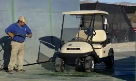 washing golf cart